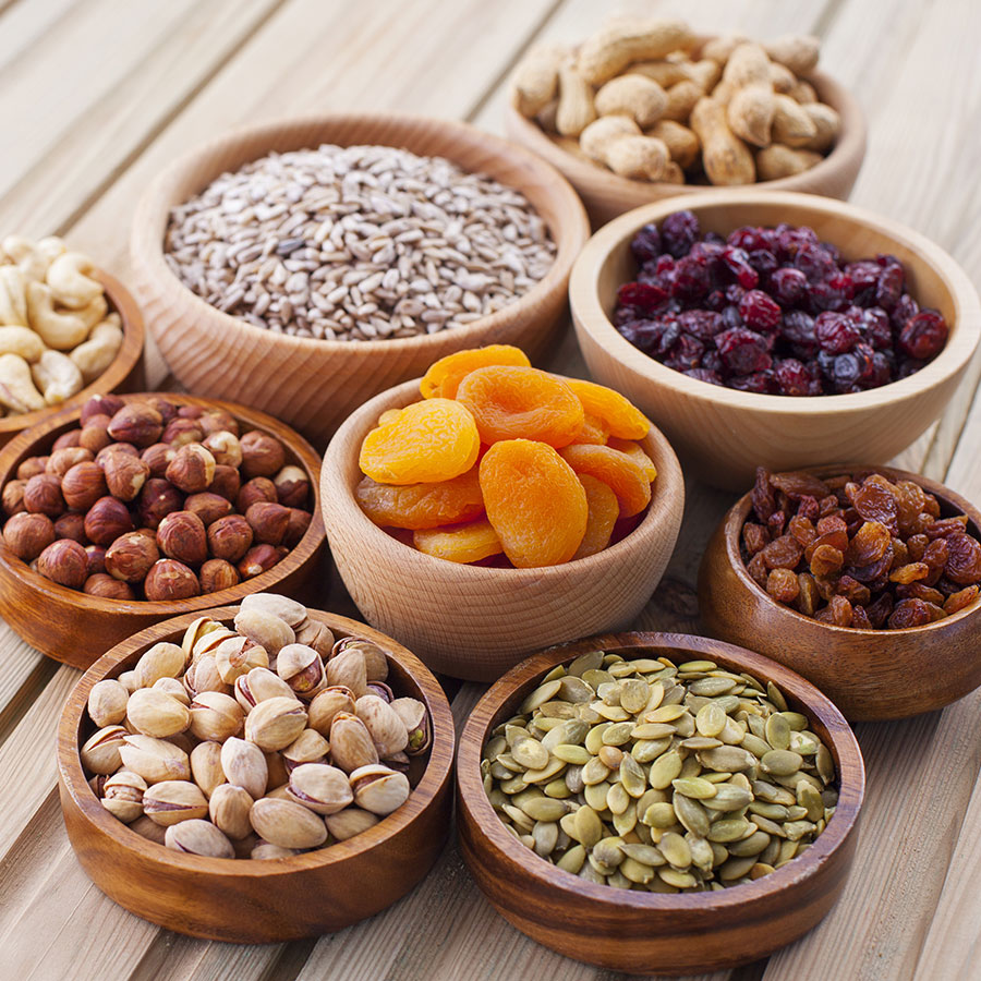 Assortment of ingredients including peanuts, sunflower seeds, and cashews sourced by Food Consultant Bernard for Restaurants in Canada